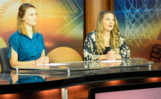 Maura and Holly read the news in our TV studio