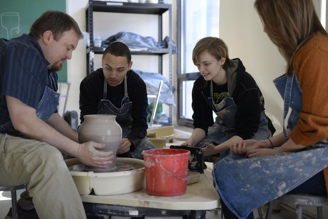 Students learn to spin pottery with Professor Heisey