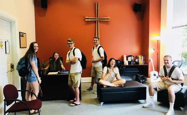 Students smiling in our Center for Campus Ministry